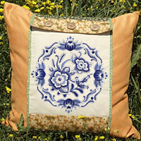 Free project instructions to create an embroidered pillow cozy.