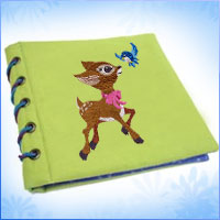 Create a fabric story book using machine embroidery designs with this free tutorial.