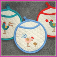Potholders embroidered with spring chickens.