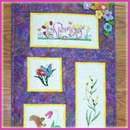 A beautiful wall hanging with spring flowers machine embroidery designs.