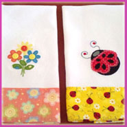 Spring flowers and ladybug embroidered on towels.