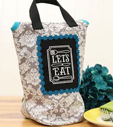 Free project tutorial to create an embroidered insulated lunch bag.