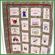 A machine embroidered quilt with farm designs.