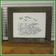 Framed machine embroidery design.