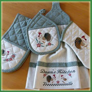 Machine embroidered pot holders and towels.