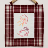 Stitch a tea towel wall hanging using machine embroidery designs with this free tutorial.