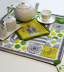 Free project instructions to make a quilted tea time table topper.