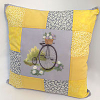 Stitch a patchwork pillow using machine embroidery designs with this free tutorial.