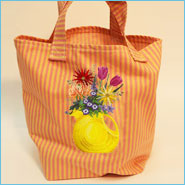 Vintage farm fresh eggs sign embroidered on tote bags.