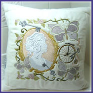 Victorian collage cushion with machine embroidery designs.