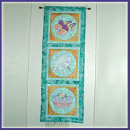 Victorian wall hanging with machine embroidery designs.