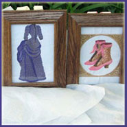 Victorian machine embroidery designs in a frame.