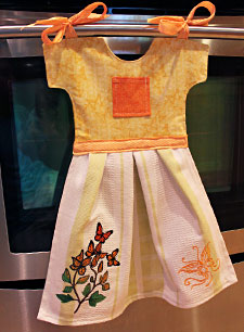 Free project instructions to make a fancy dancy towel in the shape of a dress.