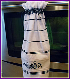 Free project instructions for a stay put tea towel with a machine embroidery design.