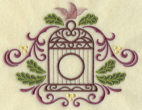 A Christmas birdcage with filigree and pine boughs machine embroidery design.