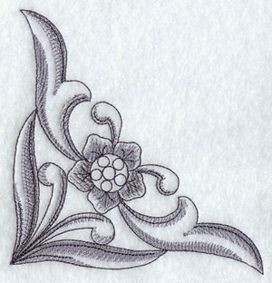 An antique floral and filigree corner machine embroidery design.