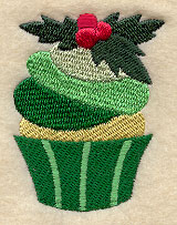 A cupcake with Christmas holly machine embroidery design.