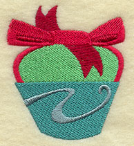 A cupcake in a ribbon machine embroidery design.