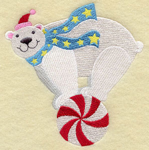 A polar bear rolls on a peppermint candy machine embroidery design.