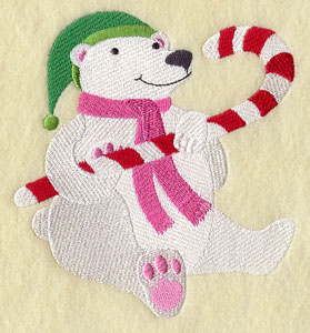 A polar bear in a scarf with a candy cane machine embroidery design.