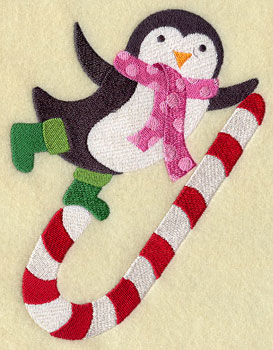 A penguin dancing on a candy cane machine embroidery design.