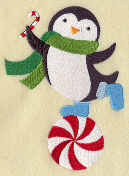 A penguin balancing on a peppermint candy machine embroidery design.