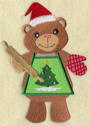 A Christmas baker bear in apron with rolling pin machine embroidery design.
