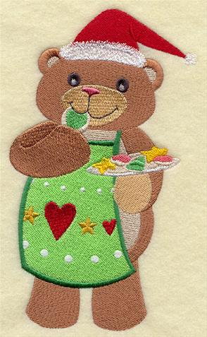 A teddy bear eats Christmas cookies machine embroidery design.