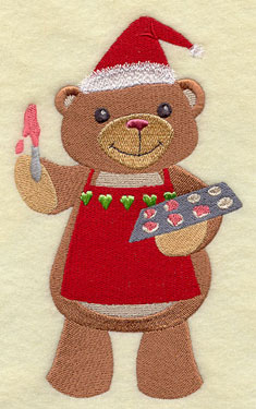 A teddy bear frosts Christmas cookies machine embroidery design.