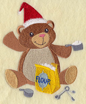 A Christmas bear in the kitchen machine embroidery design.