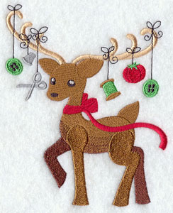 Crafty reindeer with sewing supplies hanging from his antlers machine embroidery design.
