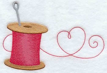 A heart and spool of sewing thread machine embroidery design.