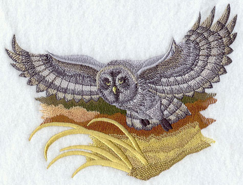 Great Grey Owl flying over field machine embroidery design.