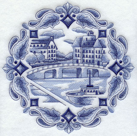 A Delft blue machine embroidery design depicting a canal scene, with a boat sailing past buildings and bridges.