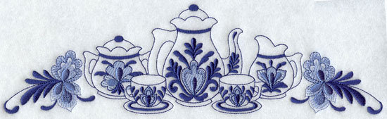 A teapot and tea cup spray in Delft blue shades machine embroidery design.