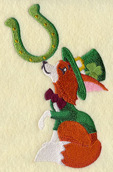 A Saint Patrick's day fox with a tophat and horseshoe machine embroidery design.