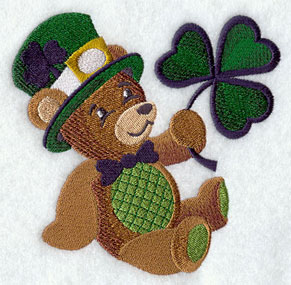 A Saint Patrick's day teddy bear with a tophat and shamrock machine embroidery design.