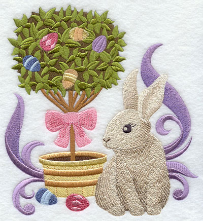 An Easter egg topiary with a bunny in a bow.