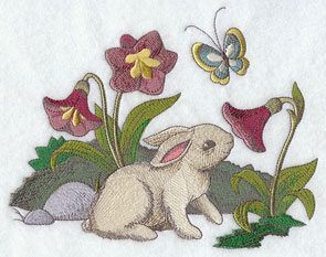 A bunny smells the flowers.