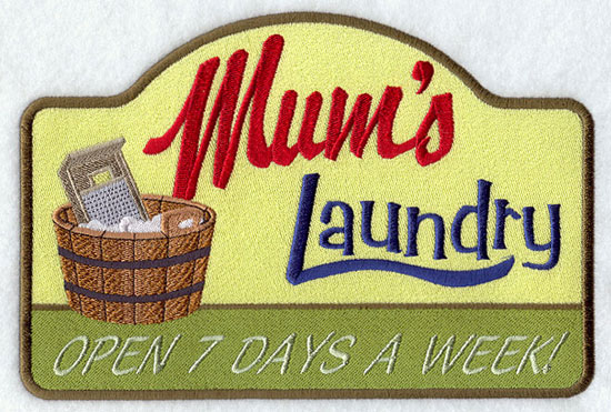 A vintage machine embroidery sign that says Mum's Laundry...open 7 days a week.