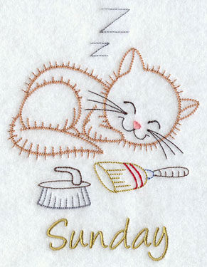 A tired kitty sleeps in a vintage machine embroidery days of the week design.