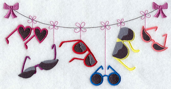 Sunglasses hang from a clothesline machine embroidery design.
