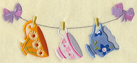 Teacups hang from a clothesline machine embroidery design.