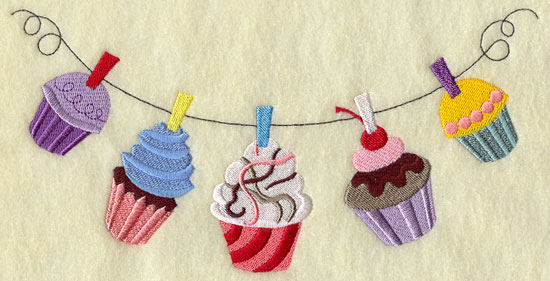 Brightly colored cupcakes hang from a clothesline.
