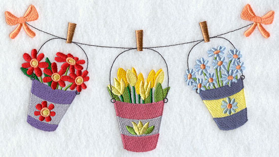 Buckets of fresh flowers sway in the breeze on a clothesline.