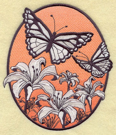 A spring oval machine embroidery design with black and white flowers and butterflies against a lightly colored backdrop.
