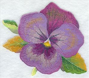 Shimmering colors give a watercolor effect to a pansy machine embroidery design.