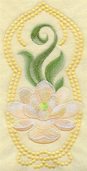 Magnolia blossom machine embroidery design with candlewicking border.