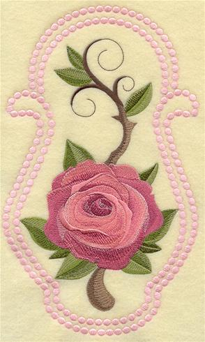 Machine embroidery Rose design with candlewicking border.