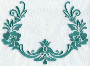 A damask machine embroidery design with open areas for monogramming.